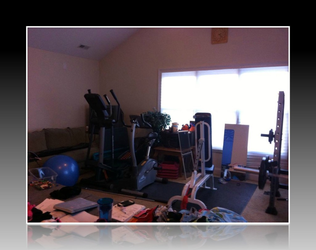 Our poor neglected elliptical and upright bike. They don't get a lot of use...To the right is a blue incline bench.