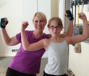 Tabitha and her daughter working out together