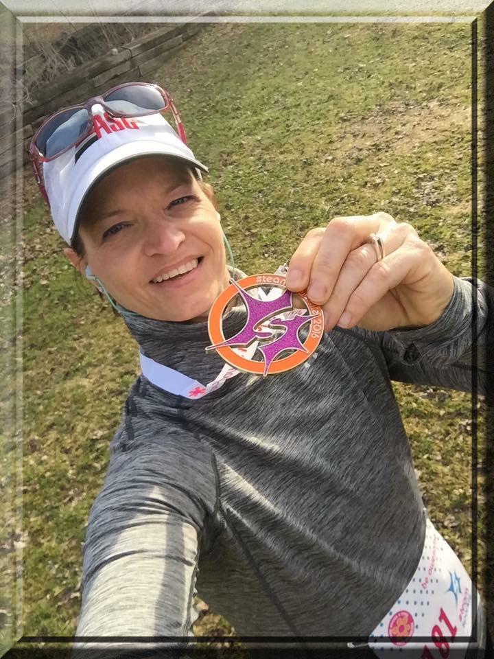 Andrea-D-Venu-holding-medal